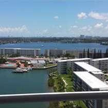 Угловая квартира в Авентуре с видом на залив, в г.Майами